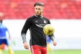 Loan star Burns misses Dons' Dubai training camp after being called back to parent club