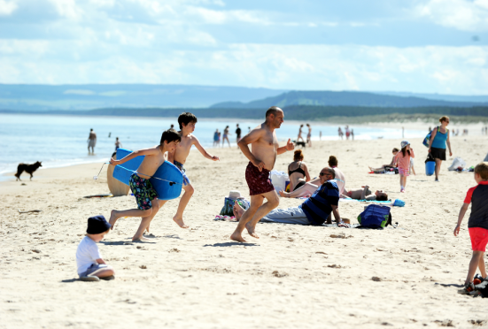 Families having fun in the sun at Lossiemouth earlier this year