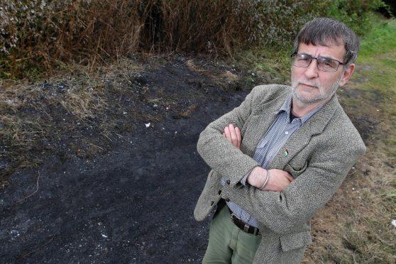 Councillor Donnie Kerr at the spot where a caravan was set ablaze on Sunday.