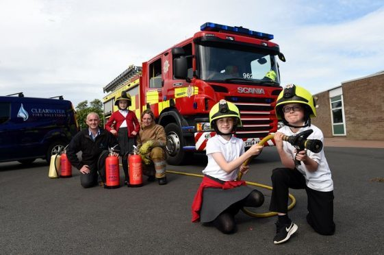 Clearwater Fire Services held a fire safety event at Balmedie Primary School with local firefighters. Picture of (L-R) Lee Morgan (Clearwater Fire Services) P6 pupil Katy, firefighter Nicolle Beattie, P6 pupils Mirrin and Dylan