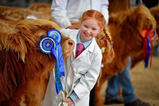 Eight-year-old Kate Cameron stands with Abernethy at the Oban sale