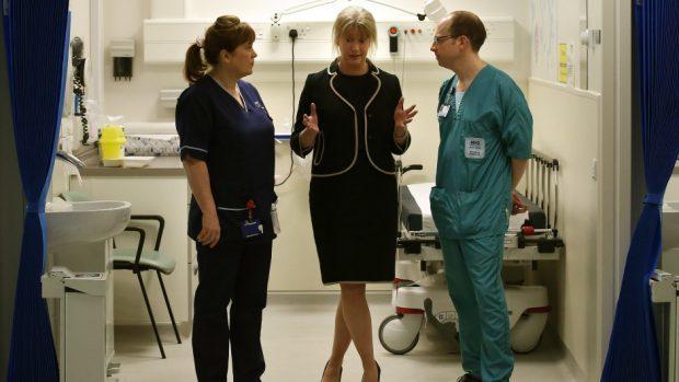 Shona Robison (centre) said health boards are recruiting more staff
