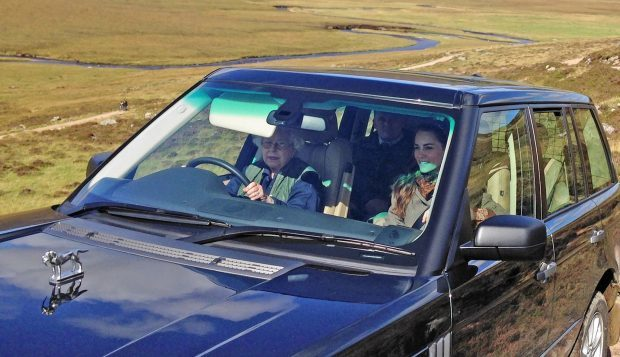 The Queen driving Kate(The Duchess of Cambridge) near Loch Muick on the Balmoral Estate.