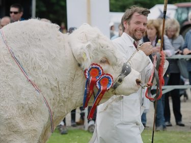 Raymond Irvine with his champion Charolais bull