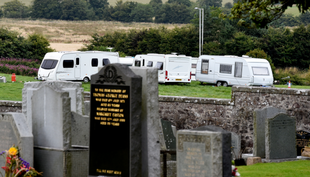 Travellers have set up close to the graveyard