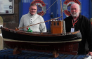 "Alan Ritchie (left of picture) presenting Dave Ramsay with the hand – made working model of his great - grandfather's boat the ""Happy Return,"" named after his return from Germany in 1918. The boat is now on permanent display in the Maggie Law Maritime Museum) Photo: Deryk McNeill"