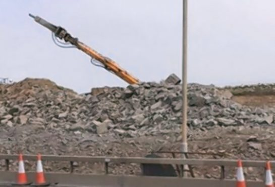 The incident emerged as photographs were released by workers on another section of the road, which showed an overturned digger on the A90 at Charleston.