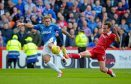 Aberdeen were beaten 3-0 by Rangers at Pittodrie on Sunday.