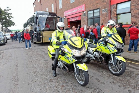 The Rangers team bus arrives at Pittodrie in 2016 with a police escort