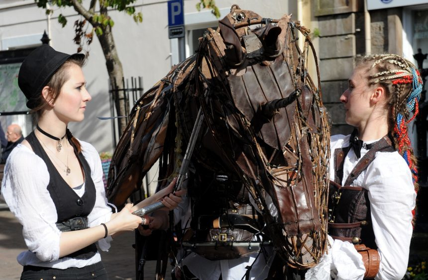 Ciara Turnbull, left, and Hannah Myers, right, with mechanical horse from Arts In Motion.