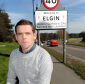 Highlands and Islands MSP Douglas Ross next to the A96 in Elgin.