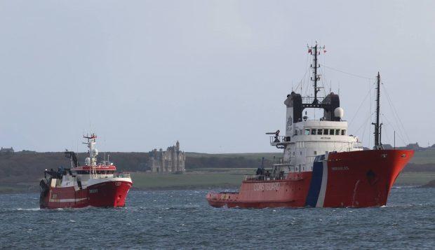 ETV Herakles towing the stricken vessel into Hatston