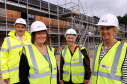 The new complex is on track to open in July. Pictured: Elgin councillor, James Allan, Lorna Cresswell, chairwoman Moray Integrated Joint Board for Health and Social Care, Alison Petch, Hanover board, and Helen Murdoch, chief executive Hanover Housing. Picture by Gordon Lennox.