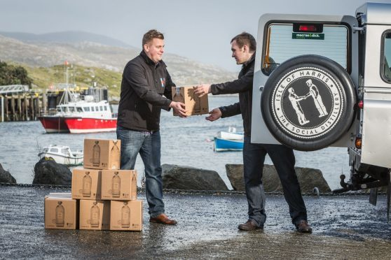 Harris Gin being loaded for delivery after fresh supplies of bottles arrived.