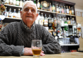 Joe Brandie behind the bar in the Fittichside Inn, Craigellachie, where he has worked for fifty-seven years with only four days off. Picture by Gordon Lennox.