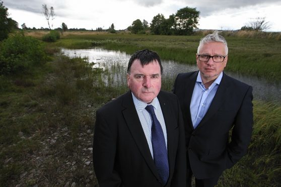 Councillor Ken Gowans and local resident George Moodie at an area of green belt land near Milton of Leys, which housing developer Tulloch Homes wants to build on.