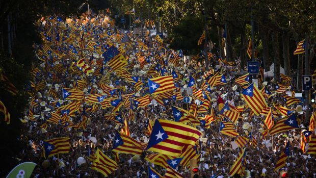 "People wave ""estelada"" flags, that symbolise Catalonia's independence, during a demonstration in Barcelona (AP)"