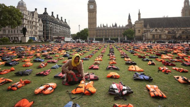 Parliament Square was transformed into a 'graveyard of lifejackets' using 2,500 lifejackets worn by refugees crossing from Turkey