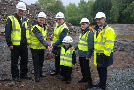 Portree Primary School pupils Jaiden Jones and Steven Colven help Councillors Drew Millar and Hamish Fraser cut the first turf for their new Gaelic school