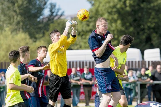 Turriff United goalkeeper Kevin Main in action against Hibs