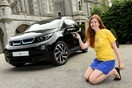 ARCHIE fundraising manager Emma Slesser outside Mercure Aberdeen Ardoe House Hotel with the all-electric BMW i3.