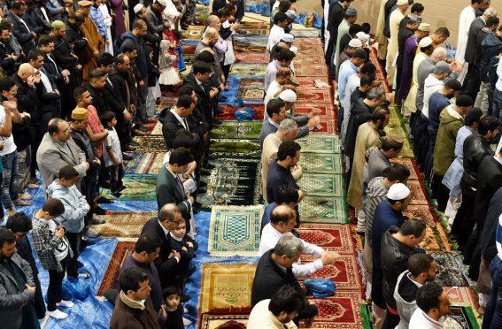 Muslims in prayer at the Aberdeen Beach Leisure Centre. (Picture: Jim Irvine)
