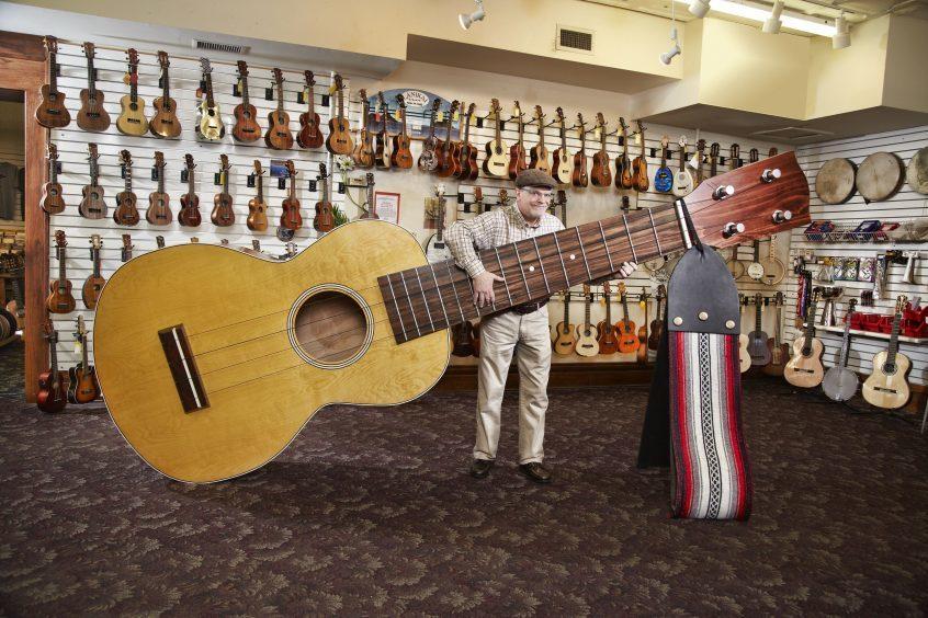 Lawrence Stump with the Largest Ukelele Elderly Instruments, Lansing, MI, USA