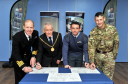 Signing of the Armed Forces Covenant at RAF Lossiemouth.  L-R: Capt Chris Smith, RN, Naval Regional Commander Scotland and Northern Ireland, Allan Wright, Convenor of Moray Council, Group Captain Paul Godfrey, Station Commander RAF Lossiemouth, and CO of 39 Engineers (Air Support) Regiment, Lt Col Jim Webster. Picture by Gordon Lennox 06/10/2016