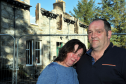 Linda Selvey and partner, Colin Smith,  in front of their burn-out home near Carrbridge. Picture by Gordon Lennox