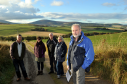L-R: Rob McHugh, Donna Nash, Joe Nash, Penny Mackenzie, and Colin Mackenzie, on the track to Auchindoun Castle with the view behind that could be threatened by the proposed power line. Picture by Gordon Lennox
