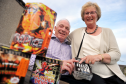 Portgordon couple George and Veronica Thow will start the village's annual fireworks display on the same day as their golden wedding anniversary.