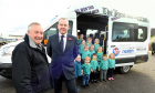 William Gray, chairman of Keith and Strathisla Community Bus Group, takes the keys for the minibus from Ray Riddoch from sponsors Nexen as children from Keith Play Centre jump on board.