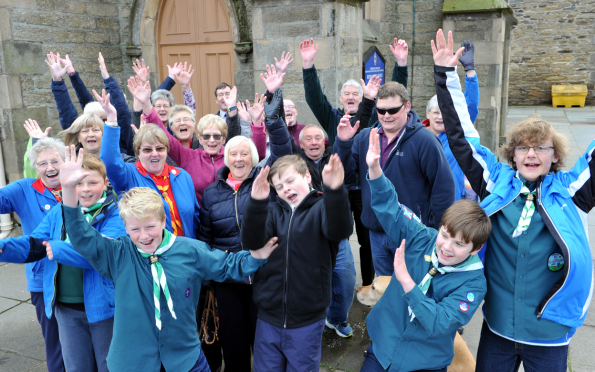 Drivers for the Keith and Strathisla Community Bus Group celebrate with some of their regular passengers.