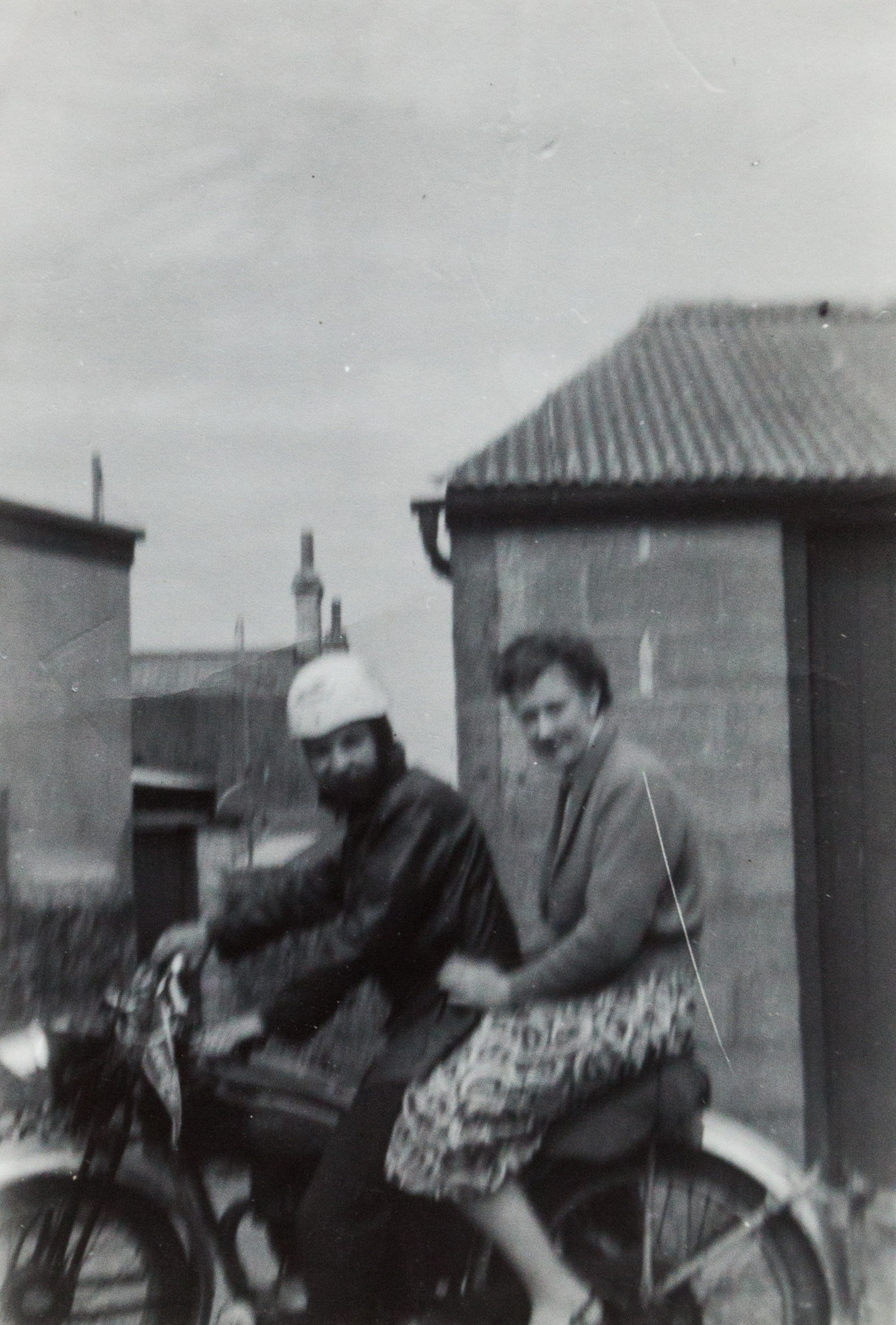 Bob and Jean Smith sitting on their motorbike in 1957