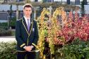 Cults Academy Head Boy, Luke Morrice, at the Bailey Gwynne memorial tree in the courtyard of the school.