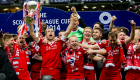 Russell Anderson celebrates with his Aberdeen team-mates as he lifts the Scottish League Cup trophy