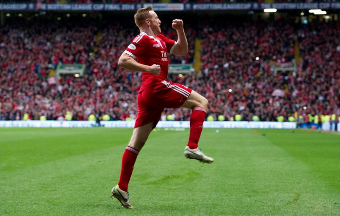 Aberdeen hero Adam Rooney celebrates his winning penalty