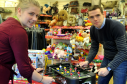Barnardo's store worker Rachel Bowler, left, and Douglas Ross MSP, right, take time out from a busy day to try out some of the toys donated to the store. Picture by Gordon Lennox.