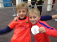 FC Barcelona fans Leo Conway(R) and Callum Adamson(L) waited at Glasgow airport to meet the palyers at Glasgow airport
