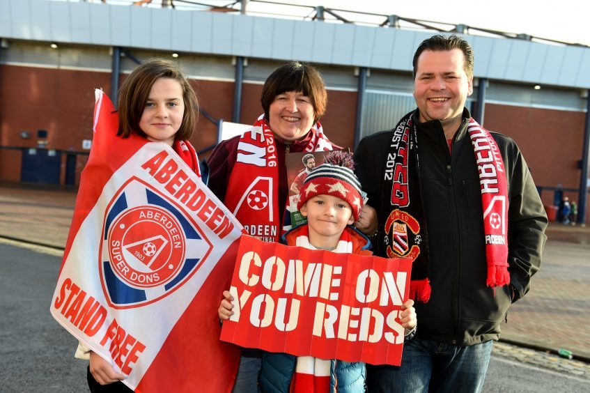 Betfred Cup final 2016 at Hampden Park. Aberdeen v Celtic.  Picture of Ella, 12, Nicola Gardyne, Angus, 9, Steve Gardyne.  Picture by KENNY ELRICK     27/011/2016