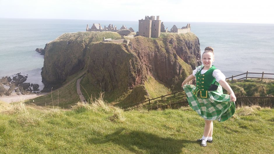 Travelling to a local dancing display, Isla MacGregor stopped by Dunnottar Castle near Stonehaven for a snap. Photograph: Torquil MacGregor