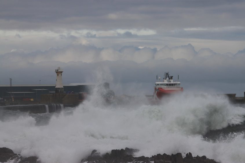 Waves storm ashore at the Harbour of Refuge, Peterhead. Picture courtesy of reader Adrian Breeman, Peterhead