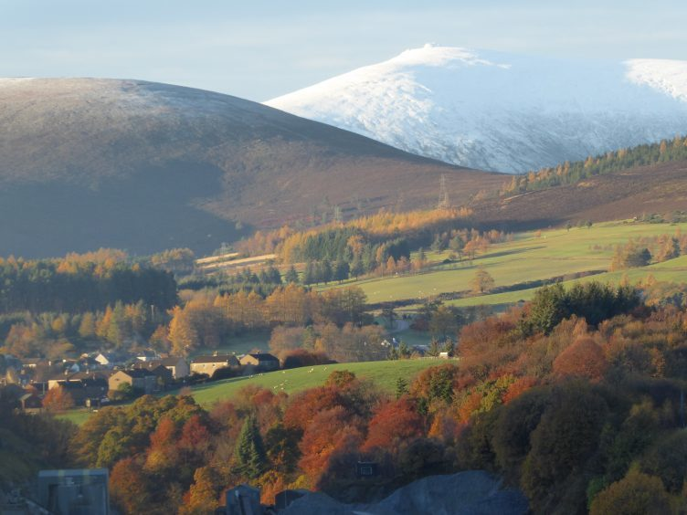 Snowy Ben Rinnes in early morning sunshine, with Dufftown in the foreground. Photograph: Bill Morrison, Huntly
