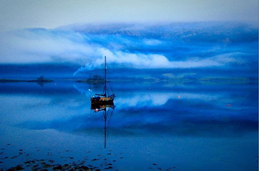 Smoke on the water, in this moodily blue view of Loch Leven at Ballachulish. Photograph: Bill Cameron