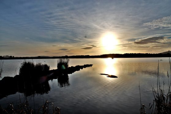 The sun setting on Loch of Skene. Photograph: Doug Gibb