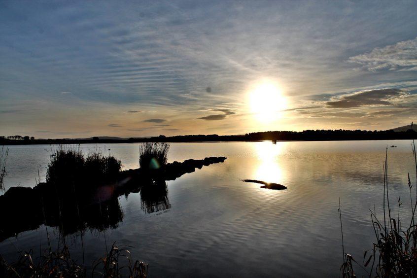The sun setting on Loch of Skene. Photograph: Doug Gibb