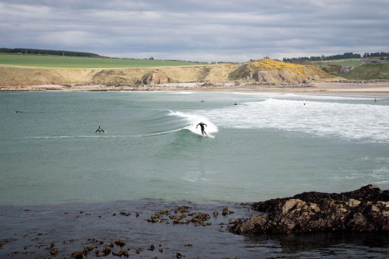 Surfing at Sandend, near Portsoy. Picture courtesy of Reader Ronnie MacAlpine, from the Isle of Lewis