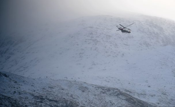 The Inverness coastguard helicopter on Ben Nevis.
