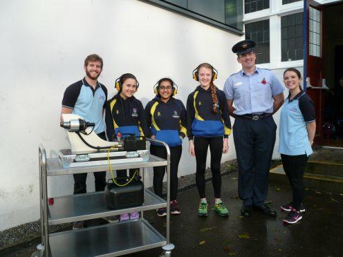 St Margaret's pupils Sara Yorston, Oishani Dutta and Bethany Riach welcome the RAF roadshow team.