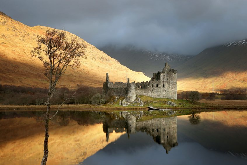 Sunrise at Kilchurn Castle, on the banks of Loch Awe, Argyll and Bute.